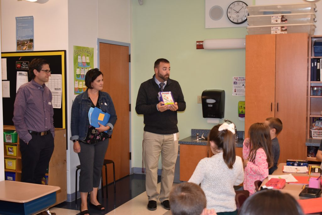 photo of dan and karen cashman presenting their program to first graders